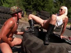 A naughty military girl sucks and fucks a guy on an obstacle course