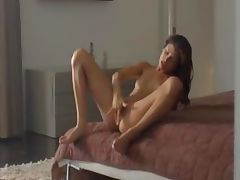 Exotic woman rubbing clit in art movie