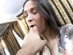 Hot brunette with tattoos fingers her pussy on the bed