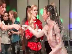 Clothed sluts get dirty in mud wrestling