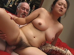Asian Amateur with a very Big Bush is Being Used by an Old Man who Gives His Cock for Sucking and then Uses Condom to Fuck Her