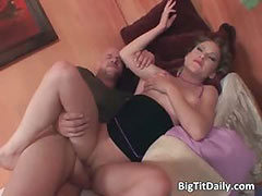Awesome brunette MILF with big tits