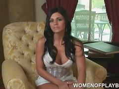 Sexy Vanessa Raia sits in an armchair and gives an interivew