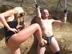 Blonde dominating over her tied slave