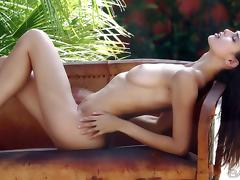 Leggy young brunette Karmen poses in her bare skin after