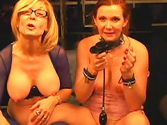 Mature mistress wearing glasses dominates redhead slave