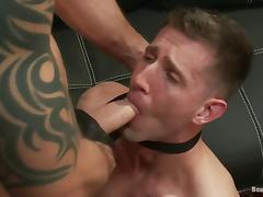 A guy in a suit gets tied up and fucked by bad biker