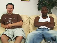 He helps his black man to put a condom on his cock